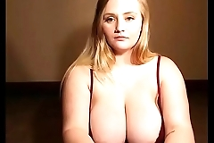 Sexy thick blonde chick teasing nice big tits on cam for free