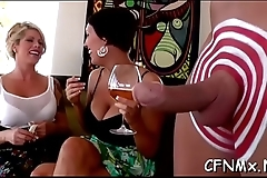 Wonderful milf gives steamy handjob during a amazing cfnm session