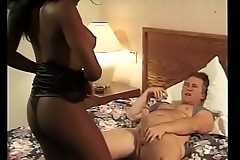 Amamzing black chick rides white cock on the big variegated bed