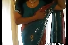 British Indian wife gives sexy strip. cum on tits
