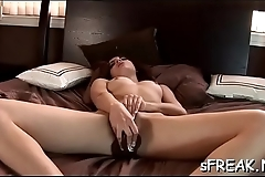 Naughty hotty shoves a dildo unfathomable  her inviting pussy
