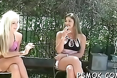 Couple takes turn oraly enchanting every other while smoking