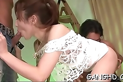 Bewitching oriental shares her twat in raucous gangbang
