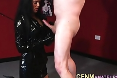 Clothed femdomina tugging